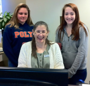 Librarian Ms. Julie with students Kelsey and Samantha.